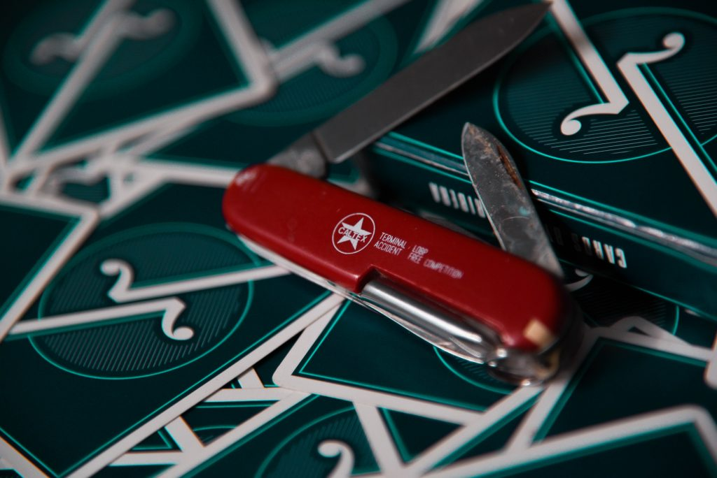 red and silver multi tool